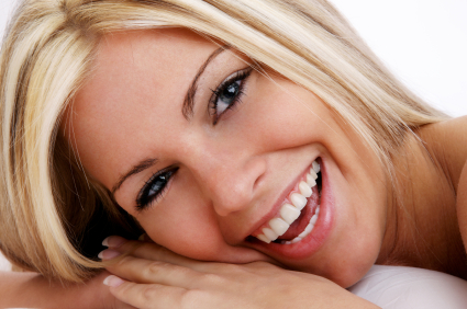 a blonde woman smiling
